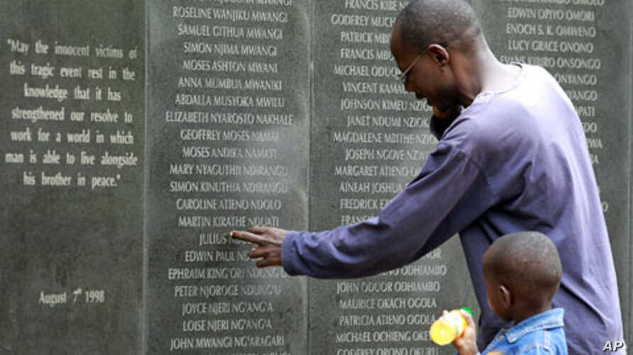 A survivor pays homage at the memorial wall with the names of 248 people killed in the 1998 bombing of the U.S.embassy are seen on the memorial wall in Nairobi  (Reuters)