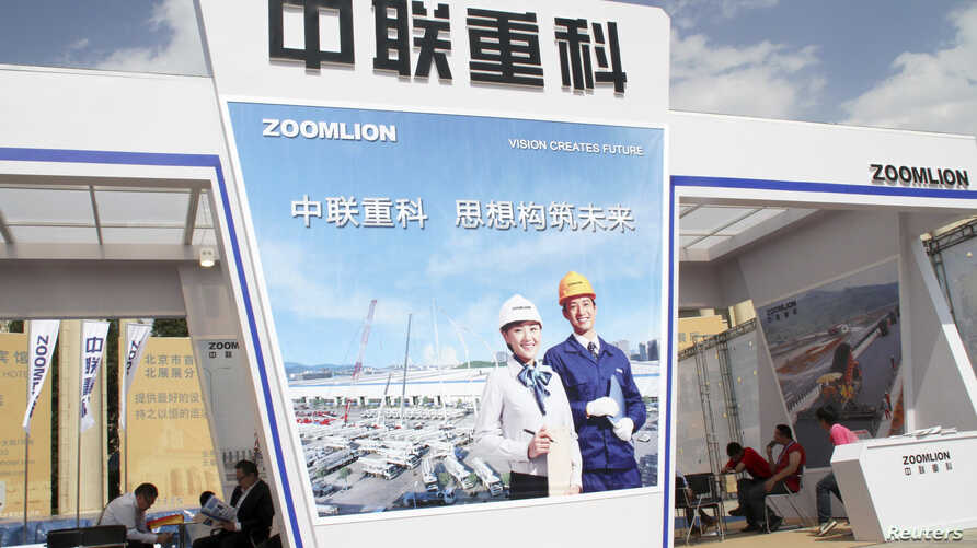 FILE - A Zoomlion booth is seen during a communication technology and equipment expo in Beijing.
