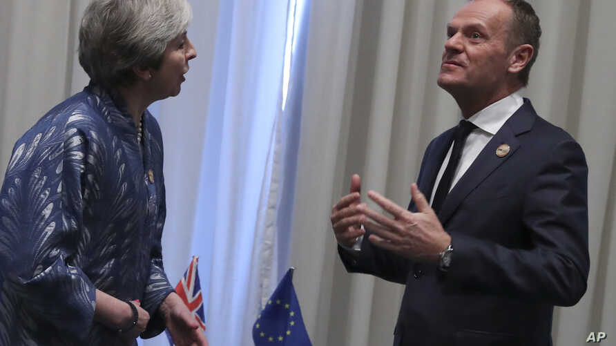 European Union Council President Donald Tusk, right, speaks with British Prime Minister Theresa May during a bilateral meeting on the sidelines of a summit of EU and Arab leaders at the Sharm El Sheikh convention center in Sharm El Sheikh, Egypt, Feb