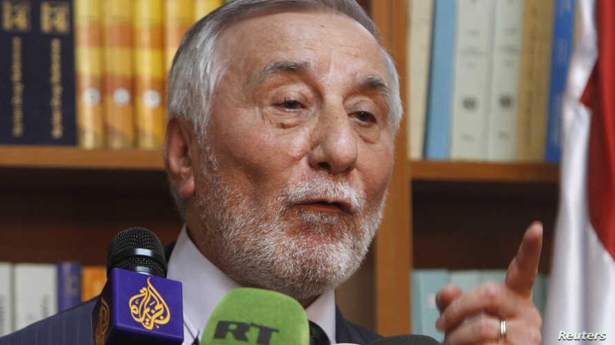 Bahjat Suleiman, Syrian ambassador to Jordan, gestures during a news conference at the Syrian embassy in Amman, May 22, 2013.