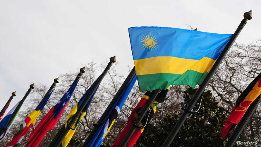FILE - The national flag of Rwanda flies amongst other flags.