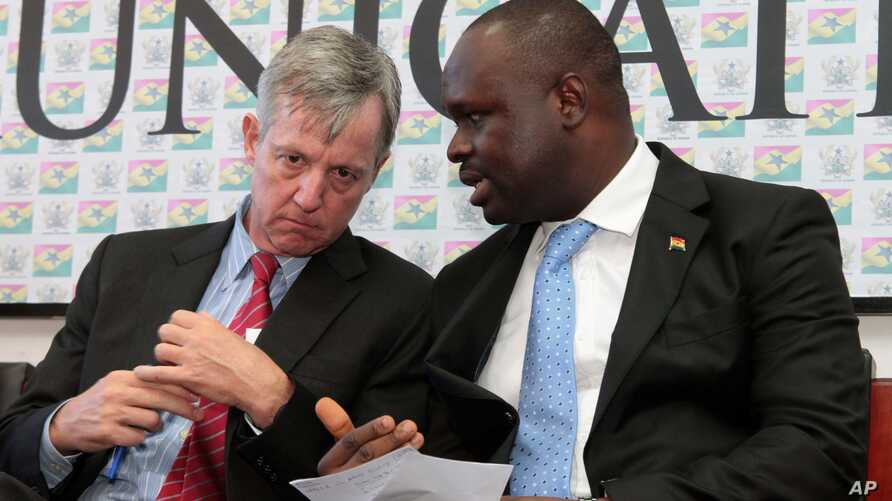 FILE - Anthony Banbury, left, outgoing head of the United Nations Mission for Ebola Emergency, speaks with Ghanaian Minister of Information Dr. Edward Omane Boamah during a press conference on Ebola, in Accra, Sept. 30, 2014.