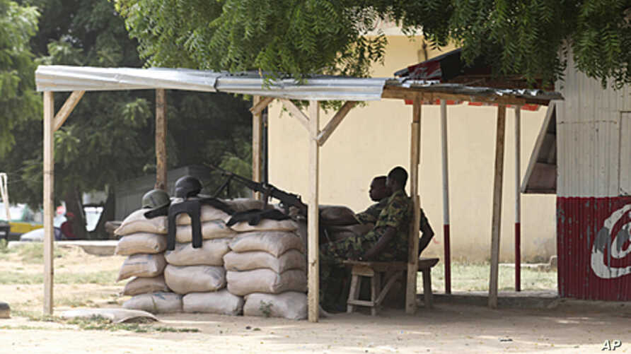 Nigeria troops man a checkpoint in Maiduguri, Nigeria, Sept, 28, 2011.