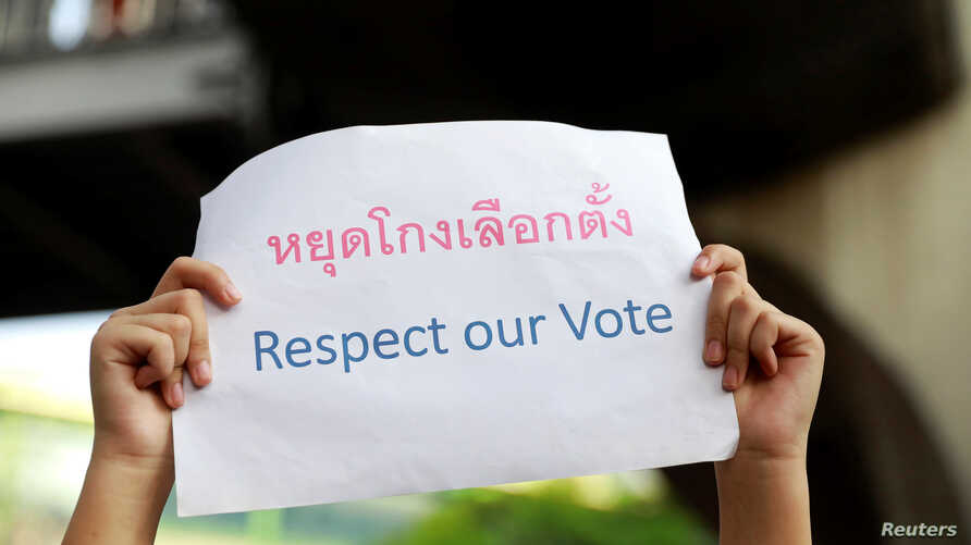 An activist holds a poster as she protests the election result in Bangkok, Thailand, March 31, 2019.