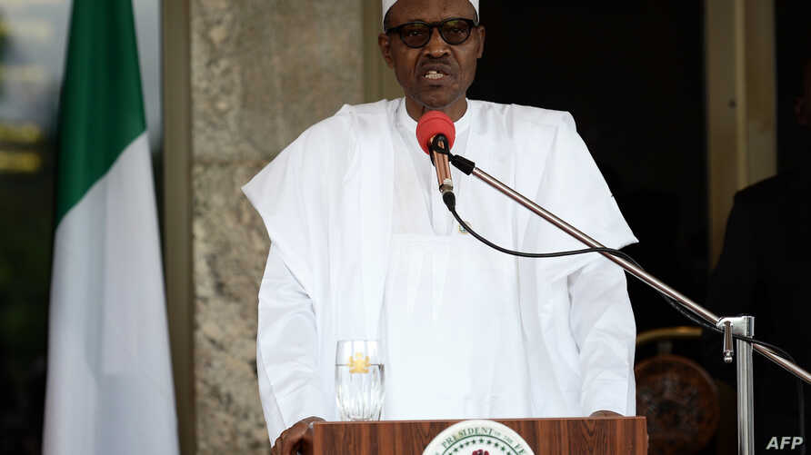(FILES) This file photo taken on May 14, 2016 shows Nigerian President Muhammadu Buhari speaking during a press conference at the Presidential Palace in Abuja.