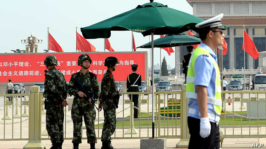 Armed Chinese police stand guard on Tiananmen Square in Beijing, June 3, 2014.
