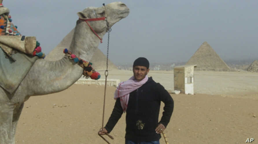 Mahmoud Adal and his camel await tourists in Giza, Egypt.