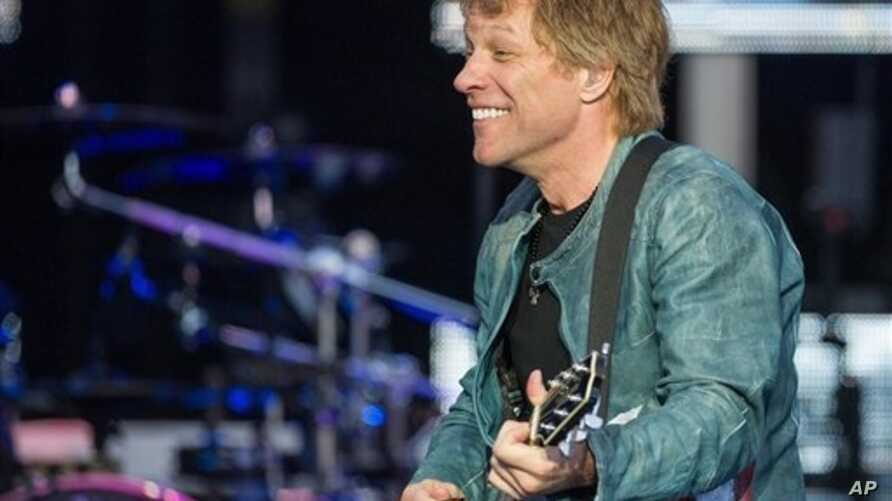"""U.S. singer Jon Bon Jovi performs on stage as part of his """"Because we can"""" tour in Munich, southern Germany, May 18, 2013."""