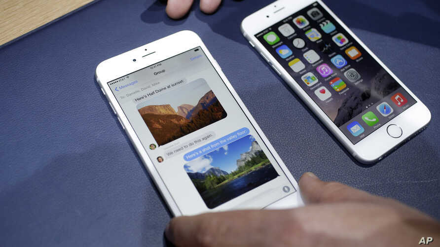 FILE - In this Tuesday, Sept. 9, 2014, file photo, the iPhone 6 plus, left, and iPhone 6 are displayed, in Cupertino, Calif.