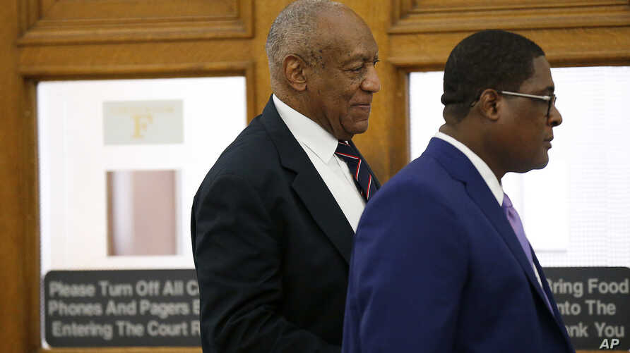 Andrew Wyatt, right, leads Bill Cosby, left, out of the courtroom during a lunch break in Cosby's sexual assault trial at the Montgomery County Courthouse in Norristown, Pennsylvana, June 12, 2017.