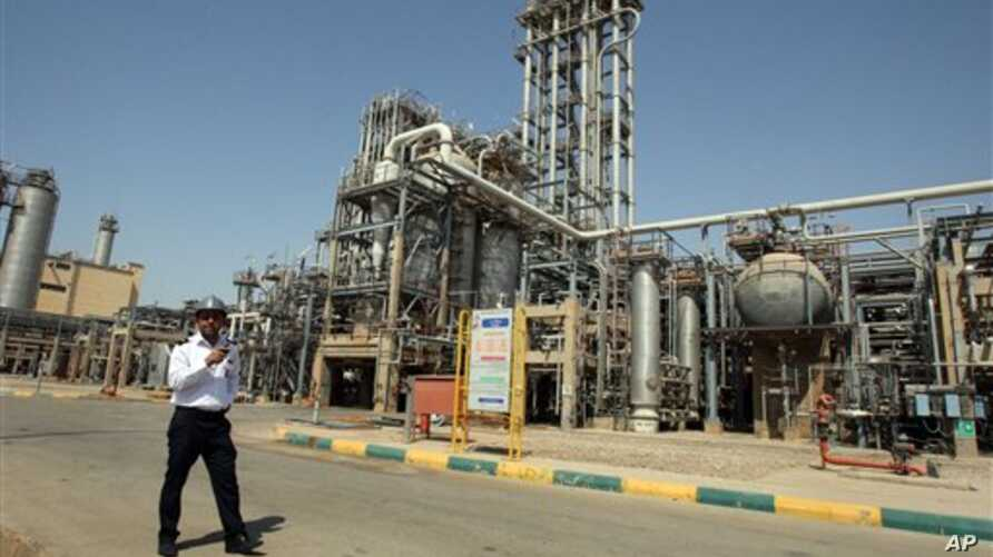 Petrochemical plant at an Iranian port. (2011 photo)  New sanctions target Iran's oil-dependent economy