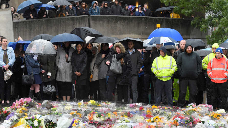 People near the scene of the recent attack observe a minute's silence in tribute to the victims of the attack at London Bridge and Borough Market, in central London, June 6, 2017.