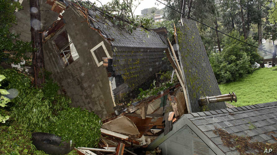 A crushed house is seen in the aftermath of a mudslide that destroyed three homes on a hillside in Sausalito, Calif., Feb. 14, 2019.