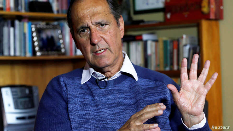 FILE - Juan Camilo Restrepo, Colombia's government representative for peace negotiations with the ELN (National Freedom Army), speaks during an interview with Reuters in Bogota, Colombia, Sept. 12, 2017.