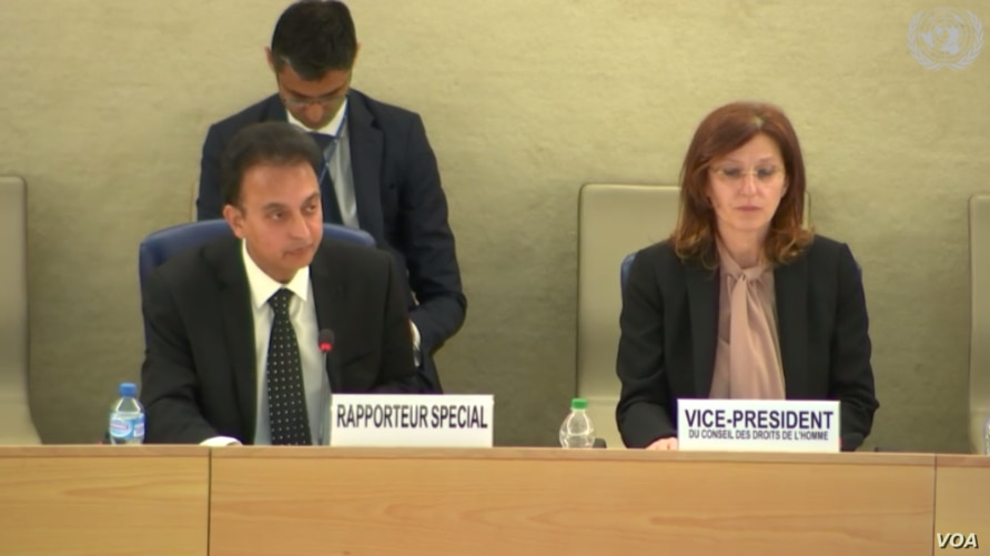 U.N. Special Rapporteur on human rights in Iran Javaid Rehman presents his annual report to the Human Rights Council in Geneva alongside Council Vice President Vesna Batistić Kos, March 11, 2019.