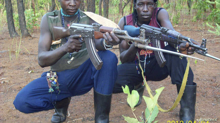 Fighters loyal to the Lord's Resistance Army (LRA) pose with their rifles inside the forest near River Mbou in the Central African Republic (CAR) in this handout picture dated April 4, 2012.