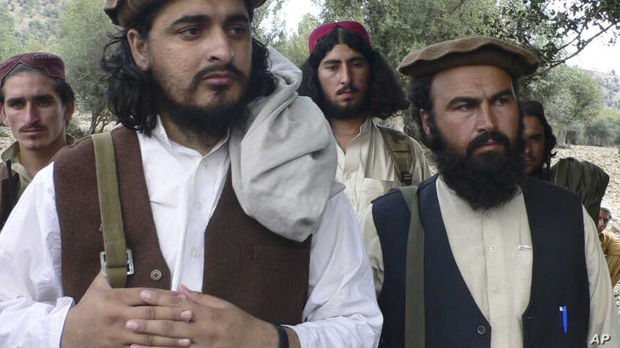 FILE - Pakistani Taliban chief Hakimullah Mehsud, left, is seen with his comrade Waliur Rehman during his meeting with media in Sararogha of Pakistani tribal area of South Waziristan along the Afghanistan border, Oct. 4, 2009.