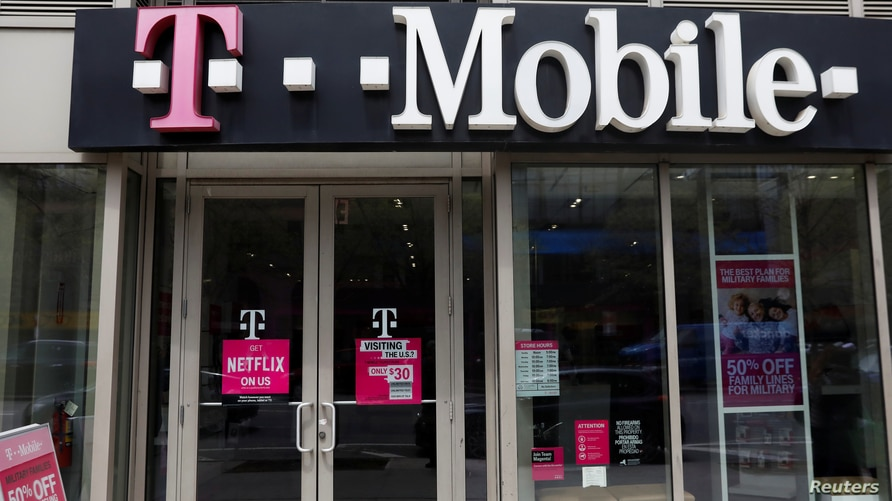 FILE - A sign for a T-Mobile store is seen in Manhattan, New York, U.S., April 30, 2018.