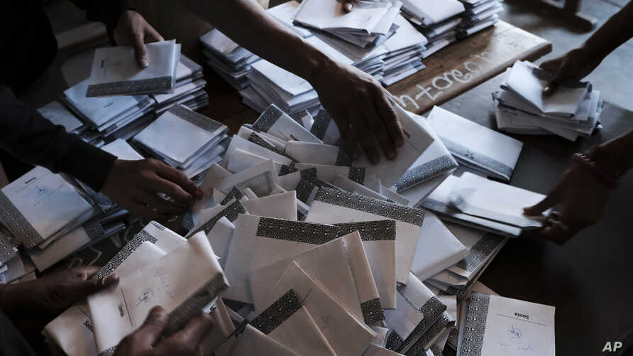Ballots are counted at the end of a days voting in Antananarivo, Madagascar, Nov. 7, 2018.