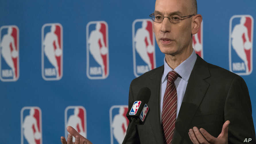 NBA Commissioner Adam Silver speaks to reporters, Friday, Oct. 21, 2016, in New York. Silver and NBA Players Association executive director Michele Roberts helped broker a tentative seven-year, collective bargaining agreement, Wednesday, Dec. 14, 201