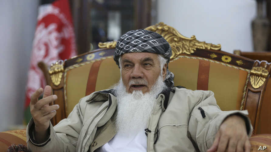 Former Afghan Cabinet minister Ismail Khan speaks during an interview with the Associated Press in Herat province, western Afghanistan, Feb. 20, 2019.