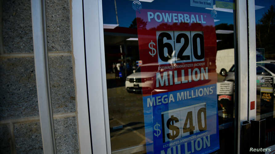 A sign advertising the next Powerball and Mega Millions jackpots at the KC Mart in Simpsonville, S.C., Oct. 24, 2018.