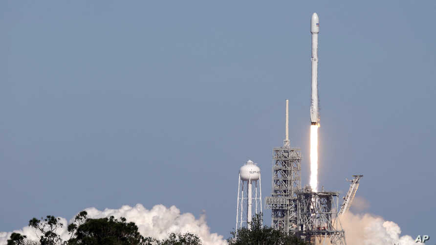 A Falcon 9 SpaceX rocket carrying a communications satellite lifts off from pad 39A at the Kennedy Space Center in Cape Canaveral, Florida, Oct. 30, 2017.