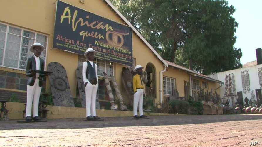 """Reine Osso runs the """"African Queen"""" Arts and Crafts store in Johannesburg, South Africa"""