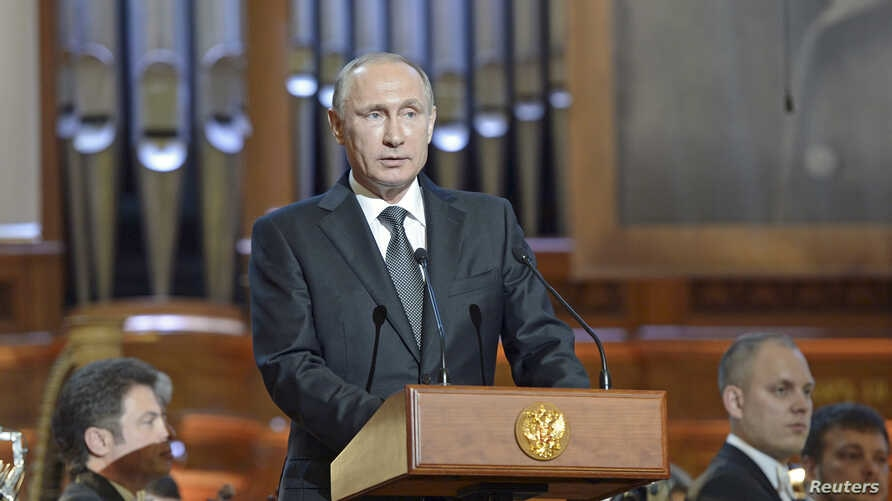 Russian President Vladimir Putin delivers a speech at the gala concert of the 15th International Tchaikovsky Competition at the Moscow Conservatory, Russia, July 2, 2015.