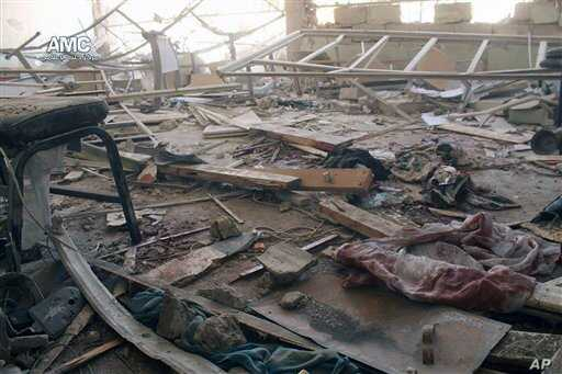 This photo provided by the anti-government activist group Aleppo Media Center, which has been authenticated based on its contents and other AP reporting, shows a damaged school that was hit by a Syrian government air strike in Aleppo, Syria, April 30