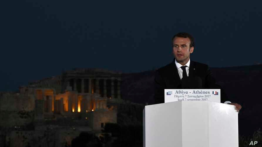 French President Emmanuel Macron delivers a speech at Pnyx hill as the ancient site of Acropolis is seen in the background in Athens, Thursday, Sept. 7, 2017. Standing at a Greek site where democracy was conceived, French President Emmanuel Macron ca