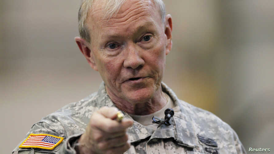 U.S. Chairman of the Joint Chiefs of Staff Army Gen. Martin Dempsey talks to U.S. military personnel stationed at Yokota Air Base in Tokyo, Apr. 25, 2013.