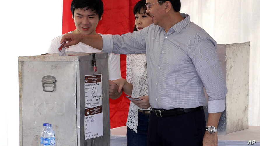 """Jakarta Governor Basuki """"Ahok"""" Tjahaja Purnama who is seeking his second term in office, files his ballot at a polling station during the runoff election in Jakarta, Indonesia, April 19, 2017."""