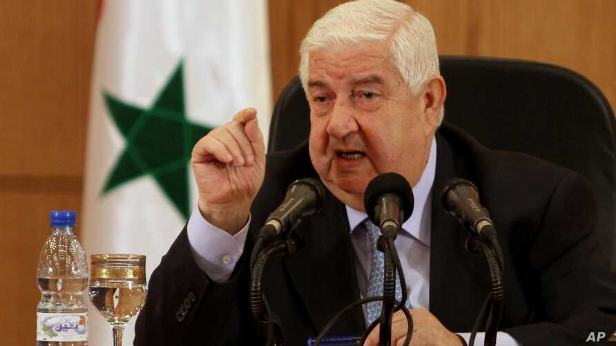 Syrian Foreign Minister Walid al-Moallem speaks during a press conference in Damascus, Syria, August 27, 2013.