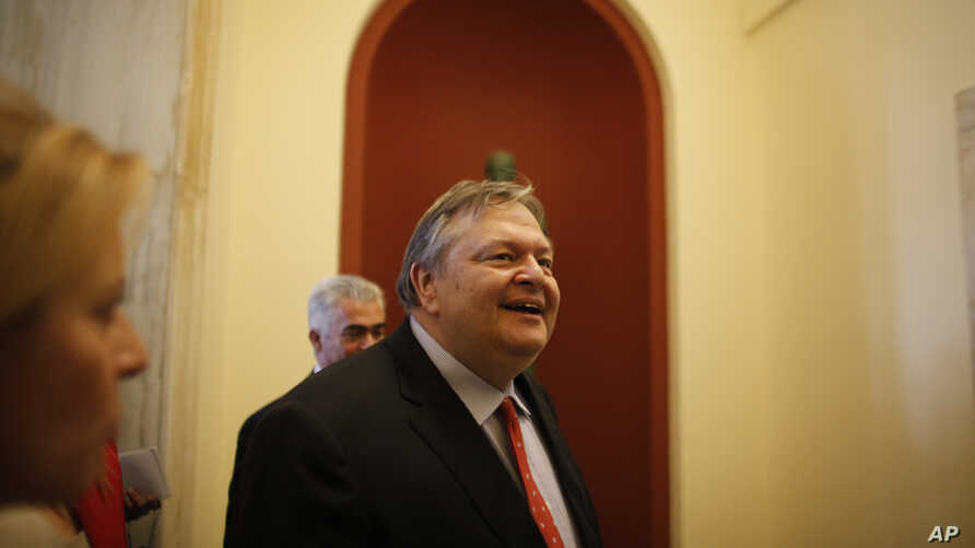 Socialist leader Evangelos Venizelos, walks inside the Parliament building after meeting with Greece's conservative election victor Antonis Samaras in Athens Monday, June 18 2012.