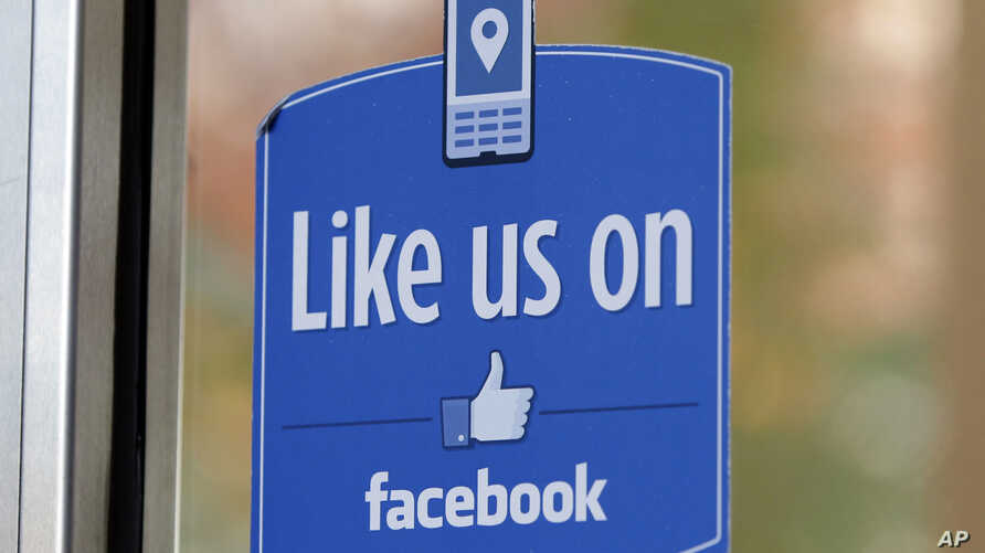 """FILE - In this Dec. 13, 2011 file photo, a sign with Facebook's """"Like"""" logo is posted at Facebook headquarters near the office for the company's User Operations Safety Team in Menlo Park, Calif."""