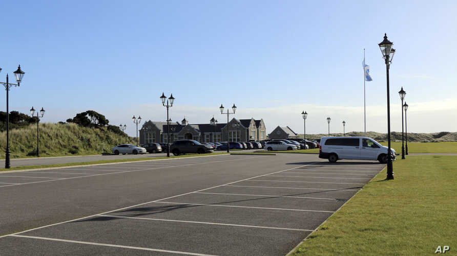 FILE - A sparsely filled parking lot is seen at the Trump International golf course in Balmedie, Scotland, Oct. 6, 2017.