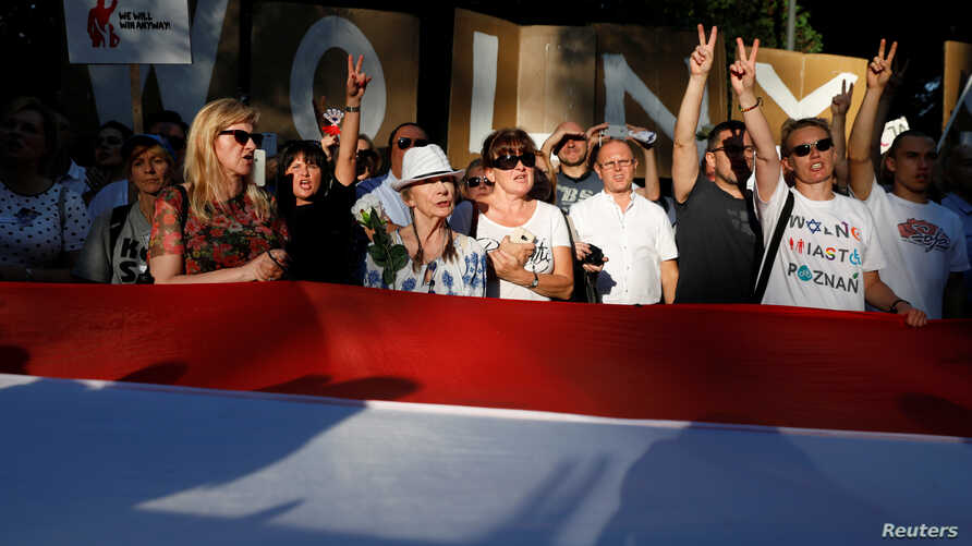 People are seen gathered during an anti-government protest in support of a free judiciary in front of the Senate building in Warsaw, Poland, July 24, 2018.