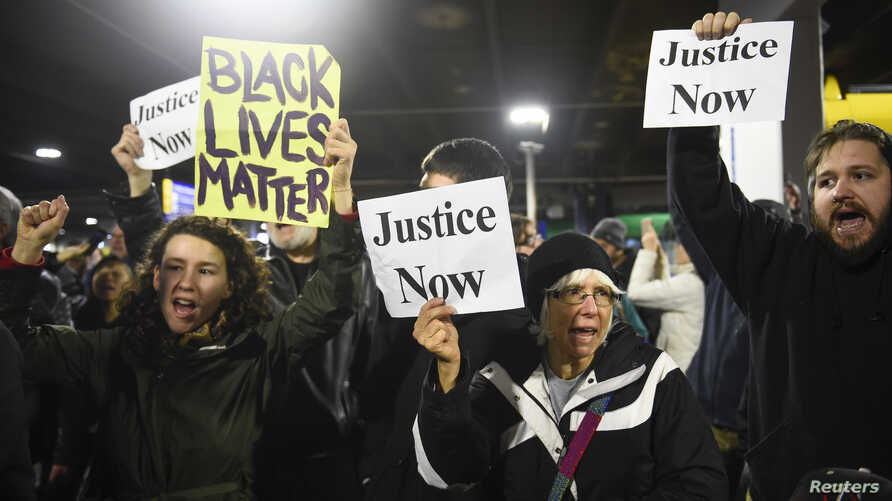Black Lives Matter protesters chant slogans at the Mall of America light rail station in Bloomington, Minnesota, Dec. 23, 2015.