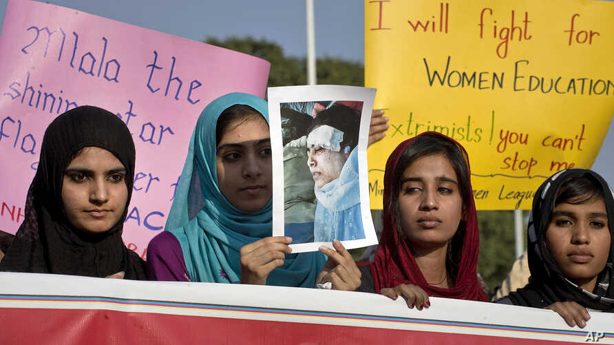 Women supporters of a Pakistani religious group 'Minhaj-ul-Quran' hold a poster of schoolgirl Malala Yousufzai, 14, who was shot on Tuesday by the Taliban, during a demonstration in Islamabad, Pakistan, Oct. 13, 2012.