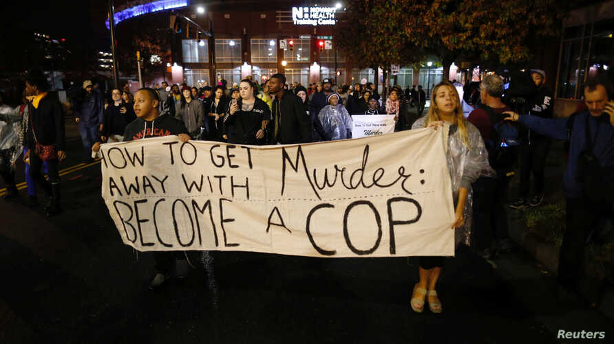 Protesters march through uptown Charlotte, North Carolina following the decision of the district attorney not to press criminal charges against police in the shooting of Keith Scott, Nov. 30, 2016.