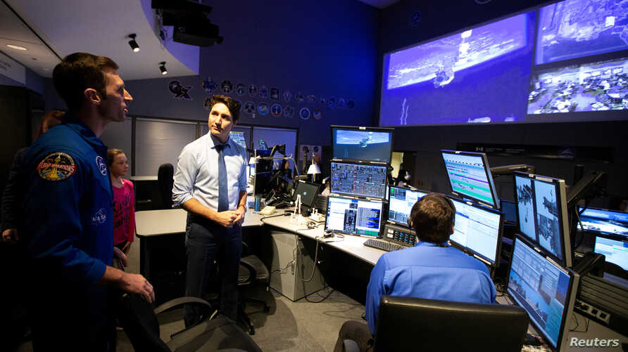 Canadian Prime Minister Justin Trudeau and his daughter Ella Grace are shown the control center by Astronaut Joshua Kutryk at Canadian Space Agency in Longueuil, Quebec, Feb. 28, 2019.