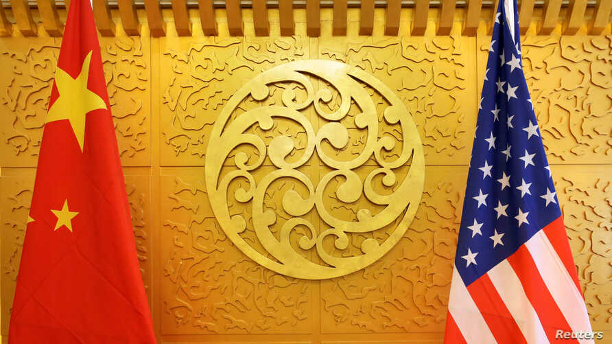 FILE - Chinese and U.S. flags are set up for a meeting at China's Ministry of Transport in Beijing, April 27, 2018.
