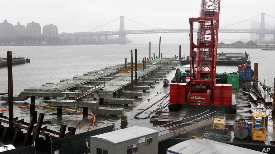 FILE - A half-finished dock for a fleet of ferries is seen in the Brooklyn Navy Yard in New York, March 28, 2017.