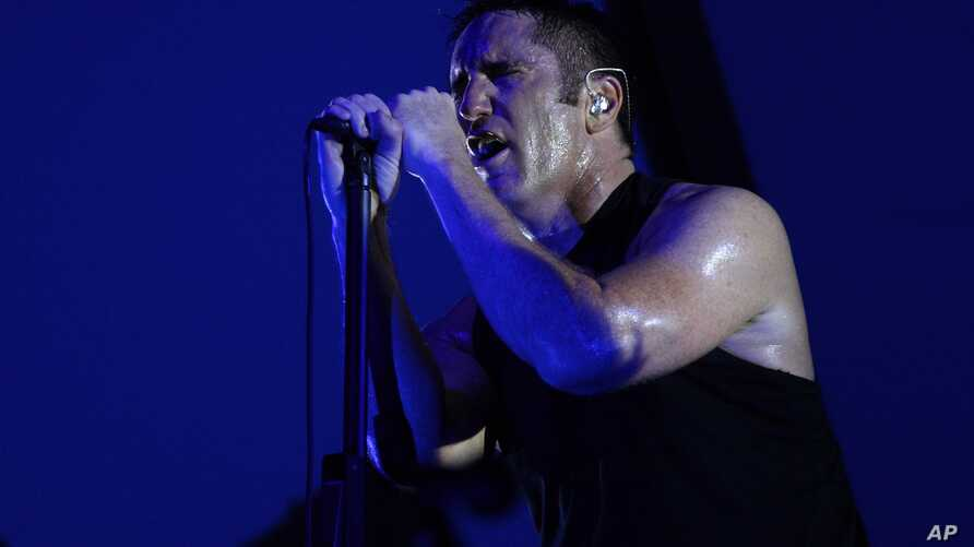 Trent Reznor of the Nine Inch Nails performs on day one of Lollapalooza 2013 at Grant Park in Chicago, Aug. 2, 2013.