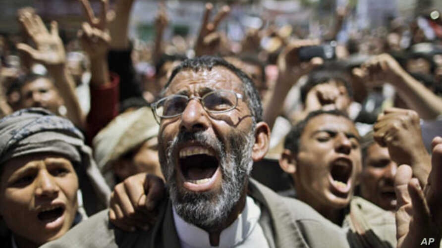 Anti-government protesters shout slogans during a demonstration demanding the resignation of Yemeni President Ali Abdullah Saleh, in Sana'a, Yemen, March 23, 2011