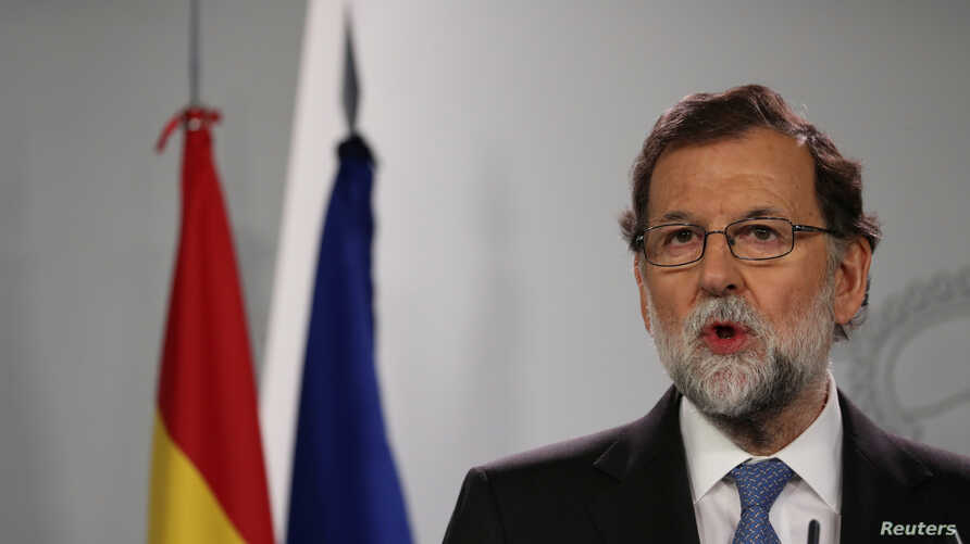 Spain's Prime Minister Mariano Rajoy delivers a statement at the Moncloa Palace in Madrid, Spain, Oct. 27, 2017.