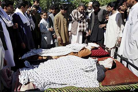Afghan villagers with bodies of loved ones allegedly killed in Afghan-led, NATO-supported operation in Laghman province, east of Kabul, May 1, 2012.