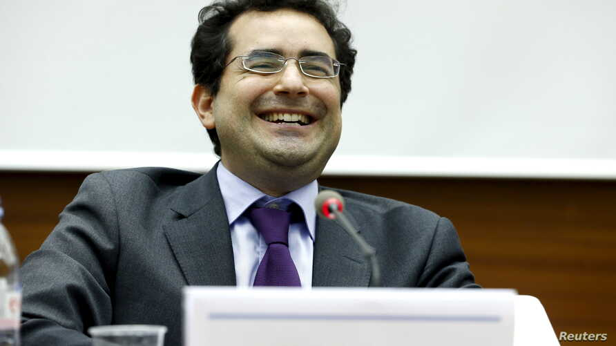 FILE - Executive director of UN Watch Hillel Neuer smiles after the presentation of a report by the Independent Commission of Inquiry on the 2014 Gaza Conflict in Geneva, June 29, 2015.