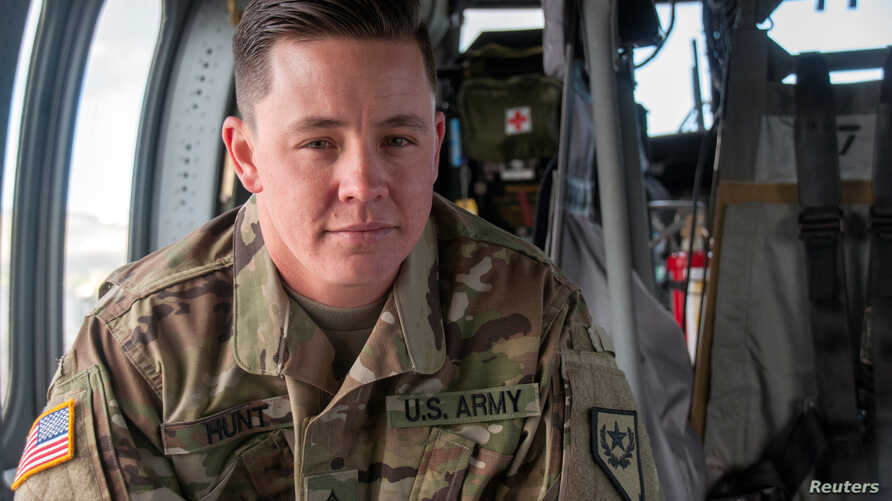 Nevada Army National Guard Sergeant Sam Hunt, an electrician with G Company, 2/238th General Support Aviation Battalion, is pictured on the flight line at the Army Aviation Support Facility in Stead, Nevada, May 12, 2017. Hunt is the first openly tra